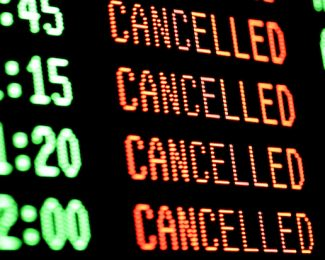 Flights cancelled on a departure board