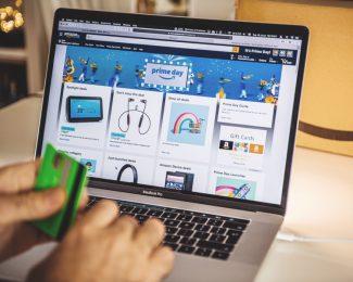 Amazon Prime day man shopping on laptop deals