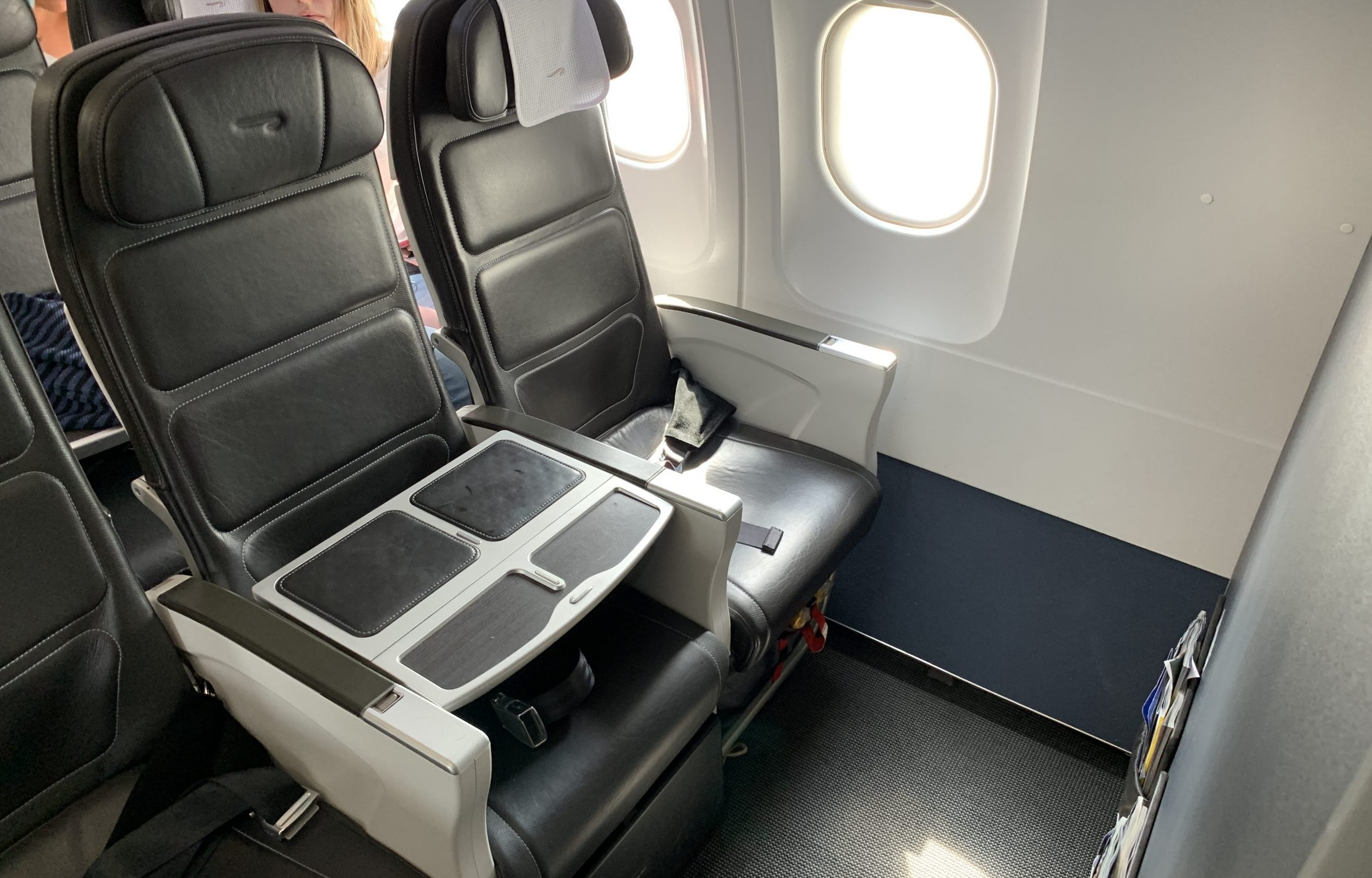 An empty row of British Airways Club Europe Business Class seats on an Airbus narrowbody.